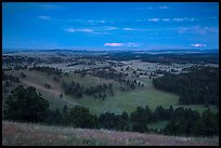 Rolling hills with distant lightening storm at dusk. Wind Cave National Park, South Dakota, USA. (color)
