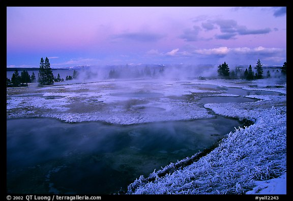 West Thumb Geyser Basin covered by snow at dusk. Yellowstone National Park, Wyoming, USA.