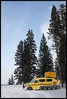 Snowcoach and trees. Yellowstone National Park, Wyoming, USA. (color)