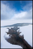 Thermal stream at edge of Yellowstone Lake in winter. Yellowstone National Park, Wyoming, USA.
