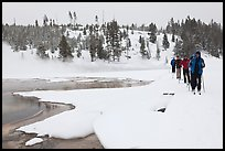 Cross country skiers pass Chromatic Spring. Yellowstone National Park ( color)