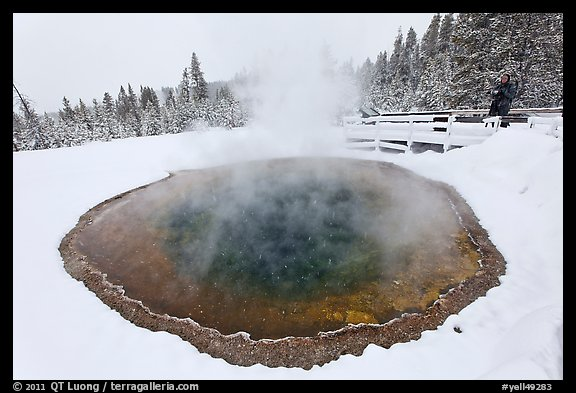 Hiker at Morning Glory Pool, winter. Yellowstone National Park (color)