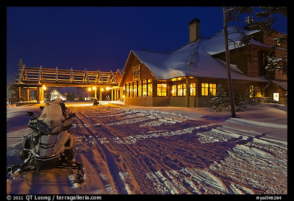 Snowmobiles parked next to Old Faithful Snow Lodge at night. Yellowstone National Park (color)