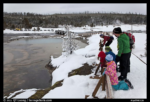 Family looks at thermal pool in winter. Yellowstone National Park (color)