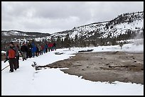 Large group of tourists in winter. Yellowstone National Park, Wyoming, USA. (color)
