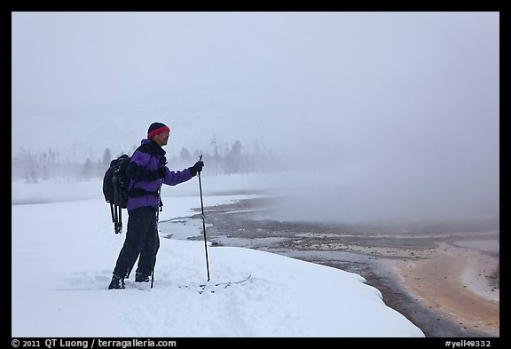 Skier at the edge of thermal pool. Yellowstone National Park (color)