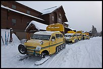 Snow busses in front of Old Faithful Snow Lodge. Yellowstone National Park, Wyoming, USA. (color)