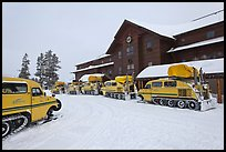 Winter Snowcoaches in front of Old Faithful Snow Lodge. Yellowstone National Park, Wyoming, USA.