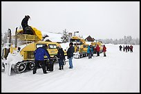 Bombardier snow busses being unloaded at Flagg Ranch. Yellowstone National Park, Wyoming, USA. (color)