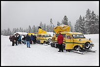 Winter tour snow coaches unloading, Flagg Ranch. Yellowstone National Park, Wyoming, USA. (color)