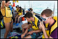 Snorklers getting ready on boat. Biscayne National Park ( color)