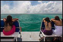 Women sunning themselves on snorkeling boat. Biscayne National Park ( color)