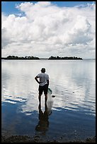 Fisherman holding net. Biscayne National Park ( color)