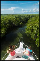 Passengers on front of boat navigating narrow channel. Biscayne National Park ( color)