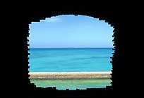 Turquoise waters framed by a cannon embrasure in Fort Jefferson. Dry Tortugas National Park, Florida, USA. (color)
