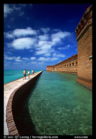 Tourists walking on seawall. Dry Tortugas National Park (color)