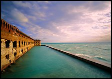 Fort Jefferson wall, moat and seawall, brighter late afternoon light. Dry Tortugas National Park, Florida, USA. (color)