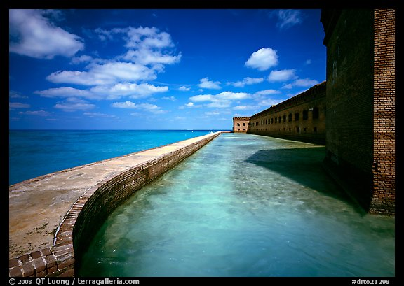 Moat with turquoise waters, seawall, and fort. Dry Tortugas National Park (color)