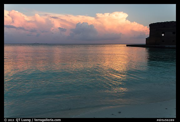 Tropical clouds, beach, and fort at sunrise. Dry Tortugas National Park (color)