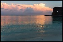 Tropical clouds, beach, and fort at sunrise. Dry Tortugas National Park ( color)