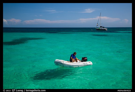 Dinghy and sailbaot in transparent waters, Loggerhead Key. Dry Tortugas National Park (color)