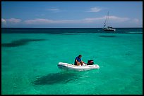 Dinghy and sailbaot in transparent waters, Loggerhead Key. Dry Tortugas National Park, Florida, USA. (color)