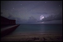 Fort Jefferson and beach at night with cloud electric storm. Dry Tortugas National Park, Florida, USA.