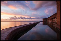 Fort Jefferson seawall, moat and walls at sunset. Dry Tortugas National Park ( color)