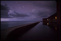 Fort Jefferson at night with stars and light from storm. Dry Tortugas National Park, Florida, USA. (color)