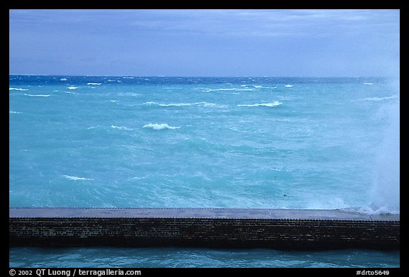 Seawall battered by surf on a stormy day. Dry Tortugas National Park (color)