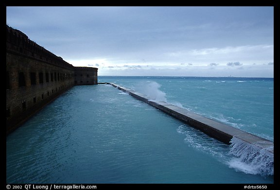Seawall and moat with waves on stormy day. Dry Tortugas National Park (color)