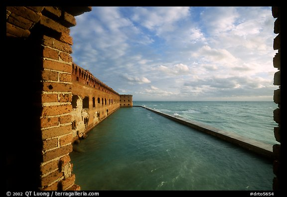 Fort Jefferson wall and moat, framed by cannon window. Dry Tortugas National Park (color)
