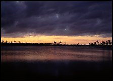 Sunset with dark clouds,  Pine Glades Lake. Everglades National Park, Florida, USA. (color)