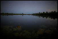 Stars and reflections in Pines Glades Lake. Everglades National Park, Florida, USA.
