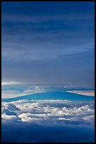 Mauna Kea above and below clouds, sunrise. Haleakala National Park, Hawaii, USA. (color)
