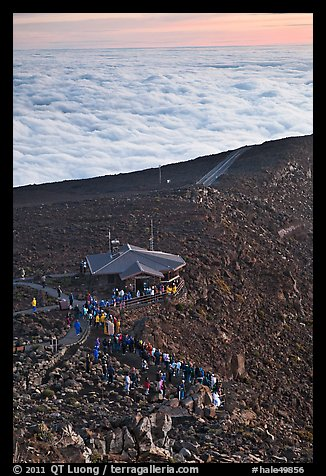 People gather to watch sunrise above sea of clouds. Haleakala National Park (color)