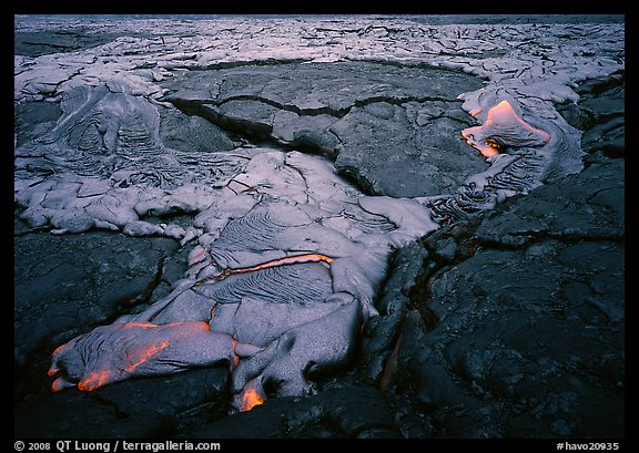 New lava flowing over layer of hardened lava. Hawaii Volcanoes National Park (color)