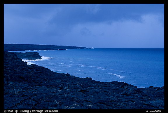 Coast covered with hardened lava and approaching storm. Hawaii Volcanoes National Park (color)