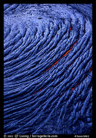 Circular ripples of flowing pahoehoe lava. Hawaii Volcanoes National Park (color)