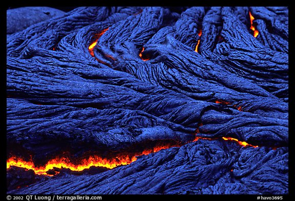 Close-up of ripples of flowing pahoehoe lava at dusk. Hawaii Volcanoes National Park (color)