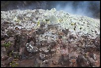 Mound of rocks covered with sulphur from vent. Hawaii Volcanoes National Park, Hawaii, USA. (color)