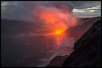 Coastline with steam lit by hot lava. Hawaii Volcanoes National Park, Hawaii, USA. (color)