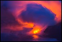 Lava steam swirls above ocean at dusk. Hawaii Volcanoes National Park, Hawaii, USA. (color)