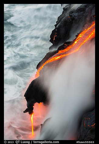 Ribbons of lava flow into the Pacific Ocean. Hawaii Volcanoes National Park (color)