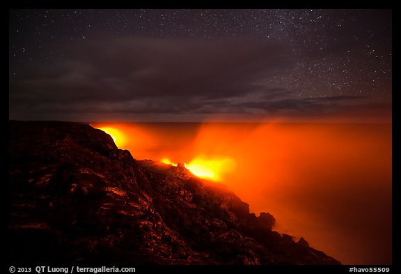 Lava makes contact with ocean on a stary night. Hawaii Volcanoes National Park (color)