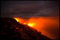 Lava makes contact with ocean on a stary night. Hawaii Volcanoes National Park, Hawaii, USA. (color)