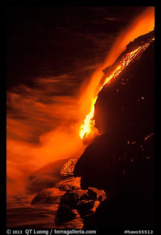 Lava flow entering Pacific Ocean at night. Hawaii Volcanoes National Park (color)