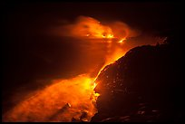 Streams of lava flow into Pacific Ocean. Hawaii Volcanoes National Park, Hawaii, USA. (color)