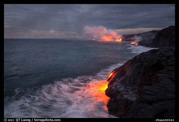 Streams of hot lava flow into the Pacific Ocean at the shore of erupting Kilauea volcano. Hawaii Volcanoes National Park (color)