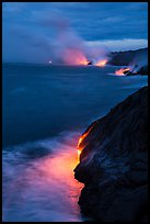 Molten lava pouring over sea cliffs at dawn. Hawaii Volcanoes National Park ( color)